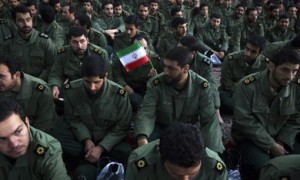 Members of the revolutionary guard attend the anniversary ceremony of Iran's Islamic Revolution at the Khomeini shrine in the Behesht Zahra cemetery