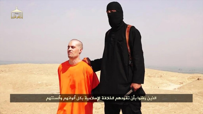 Islamic State Says Beheads U.S. Journalist; Warns Obama That Another Missing U.S. Journalist Is Next