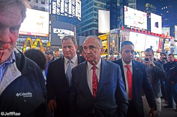 PHOTO: Protester Throws Fake Blood At NYPD's Commissioner Bratton