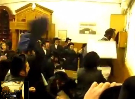 WATCH: Interesting Chassidish Minhag While Lighting Menorah - To Throw Towels At Person Lighting Candles