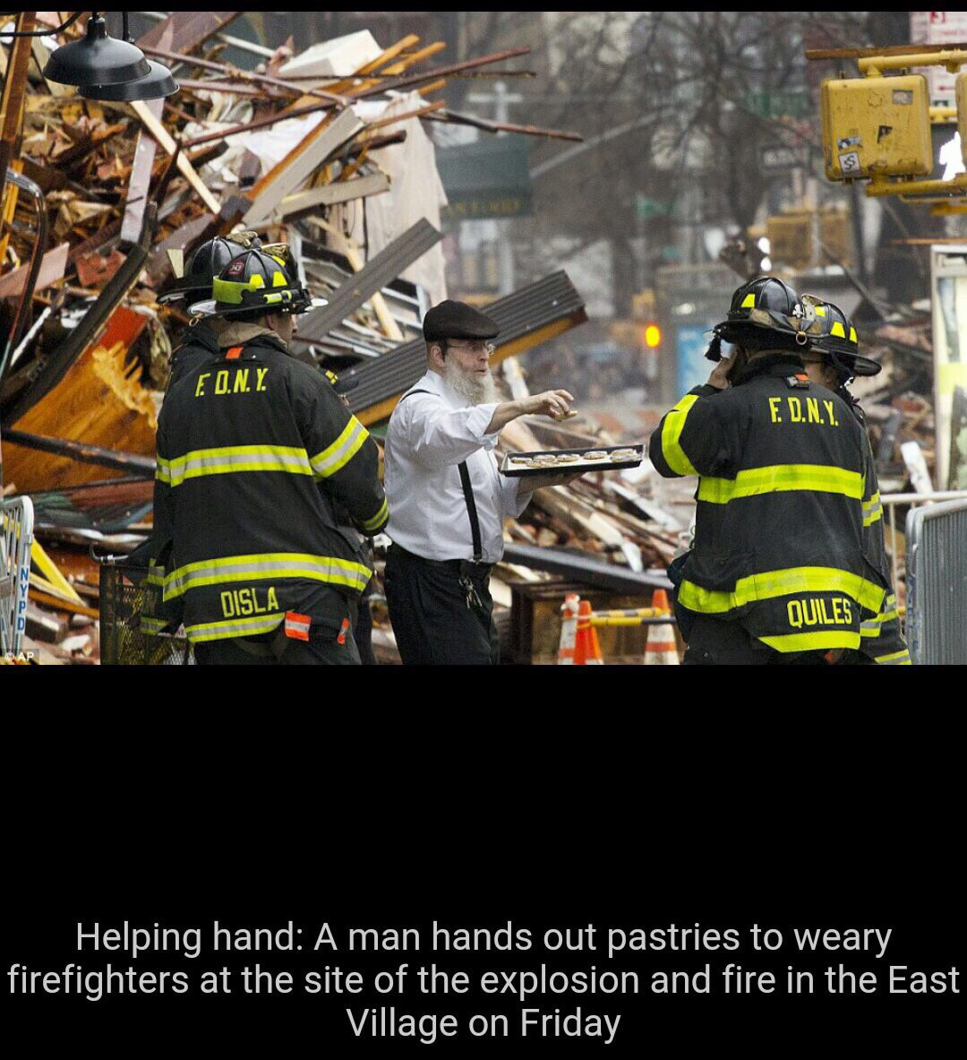 PHOTO: Chasidic Man Makes Kiddush Hashem At Scene of Manhattan Building Collapse By Handing Out Pastries