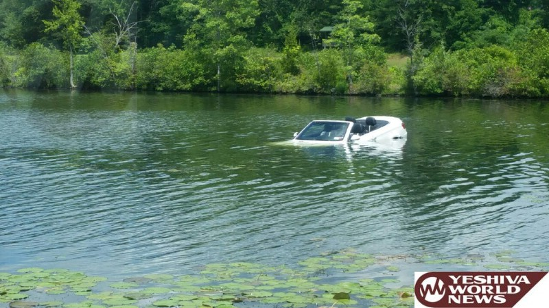 PHOTO: Car Into Lake Just Outside Of Monroe - Occupants Manage To Get Out