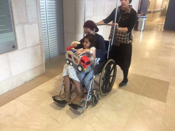 Terror Victim Mrs. Adele Benita Released from the Hospital with Her Child