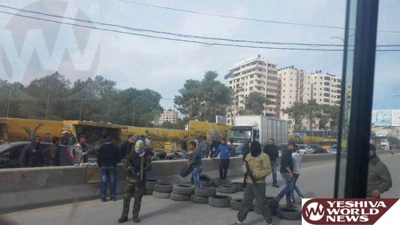 PHOTO: Armed Masked Terrorists on the Road Between Ramallah and Jerusalem