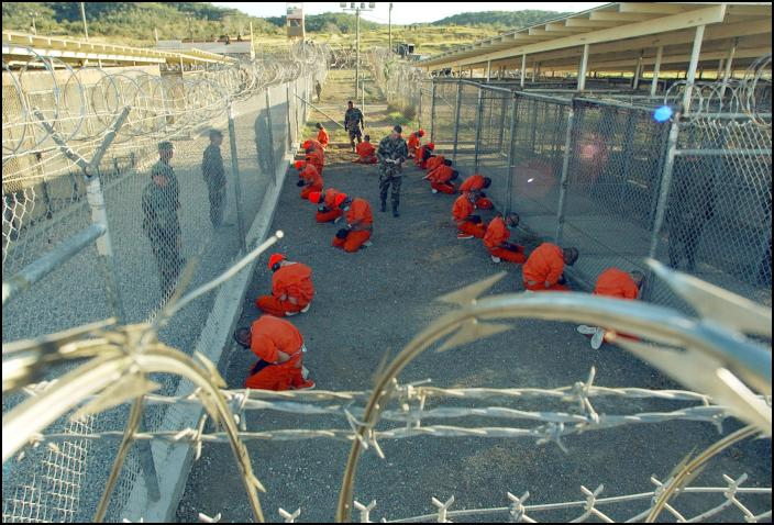 Obama Signs Defense Bill Despite Guantanamo Provisions