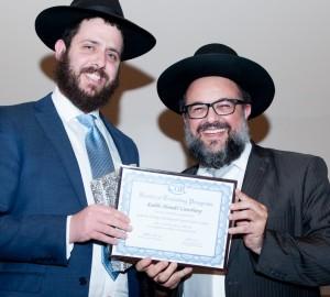 Rabbi Mendel Gansburg receiving his diploma from Rabbi Yoseph Oziel