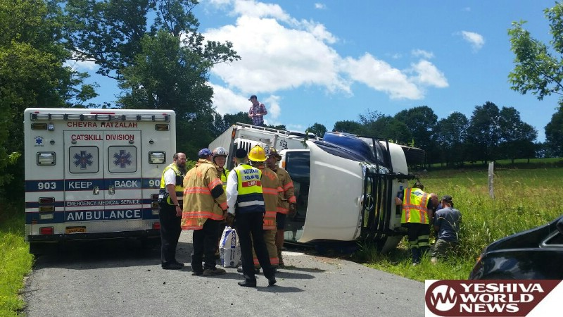 PHOTOS: Truck Overturns In Swan Lake On Butrick Road On Tues Afternoon; No Serious Injuries (Photos By Yitzchok E)