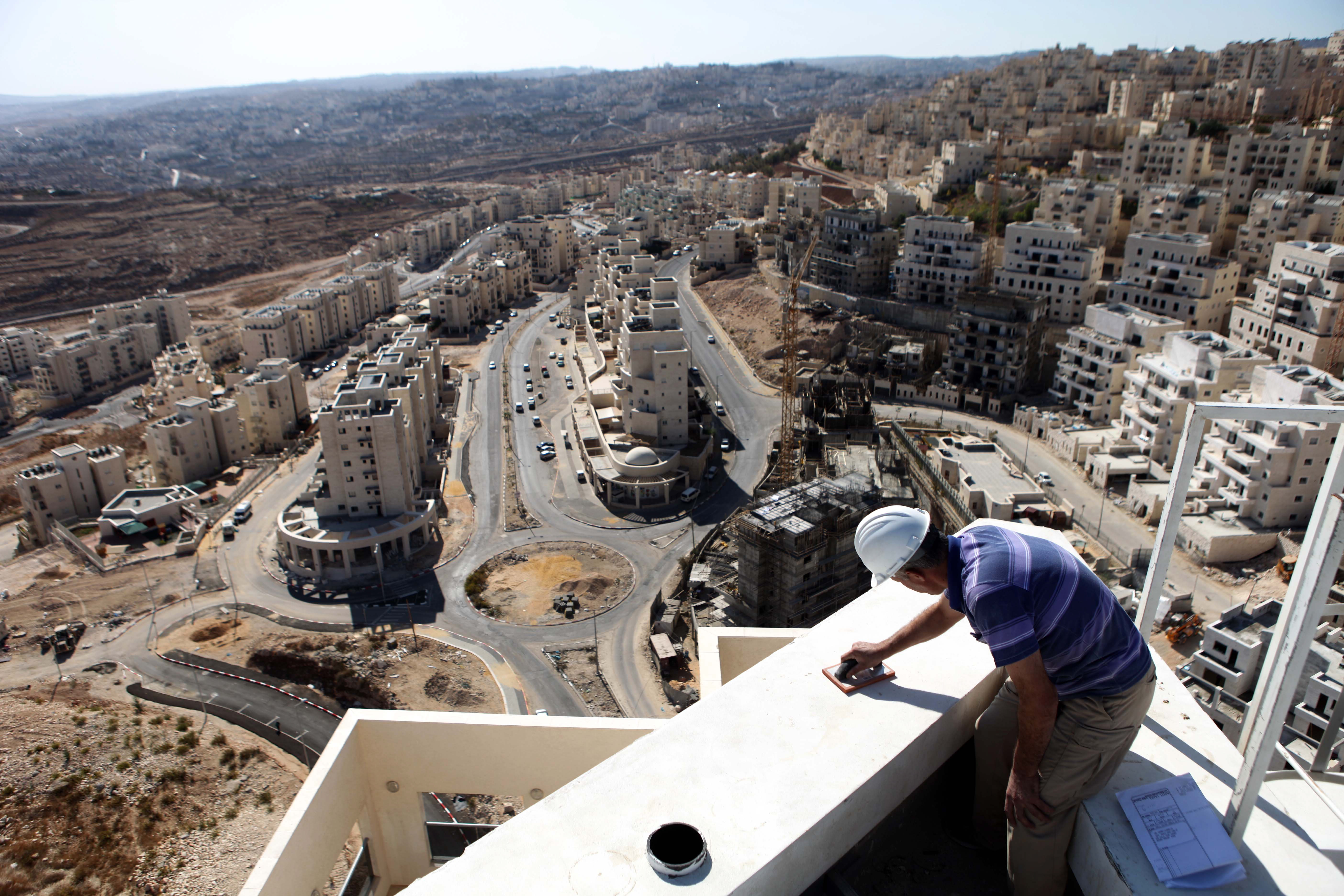 A construction worker at a site of a new housing unit in the east Jerusalem neighborhood of Har Homa