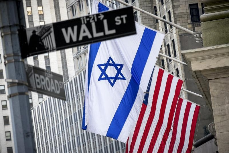 The Israeli flag hangs outside the New York Stock Exchange on Wall Street in New York