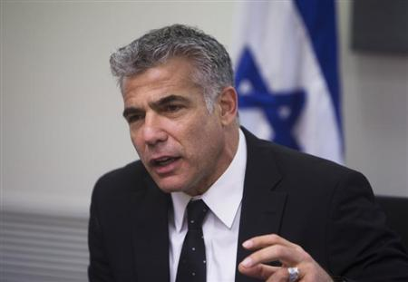 Lapid speaks during a Yesh Atid party meeting, at the Knesset, the Israeli parliament, in Jerusalem