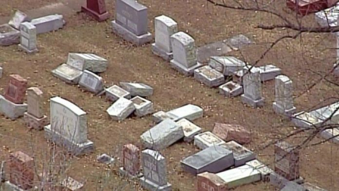Vandals destroy 100 headstones at Jewish cemetery