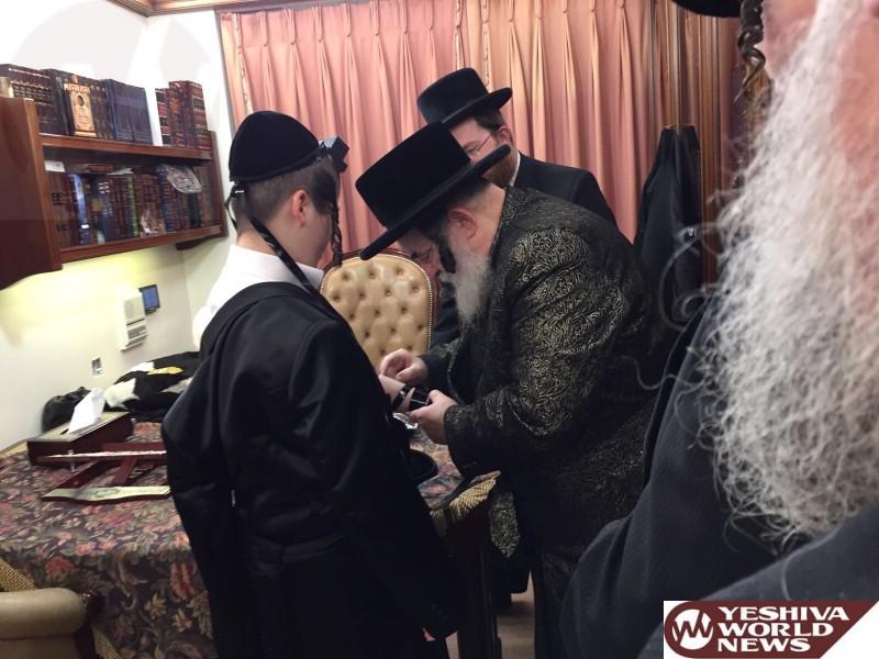 Photo Essay: The Visnitzer Rebbe Putting Tefilin On A Bar Mitzvah Bochur In London (Photos by JDN)