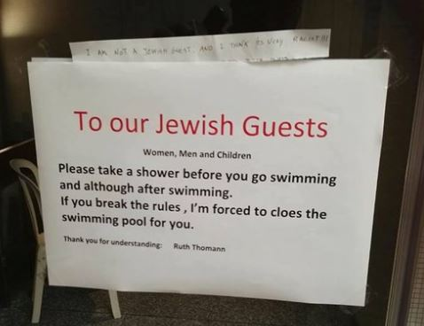 Swiss hotel sorry for signs telling Jews to shower before entering pool