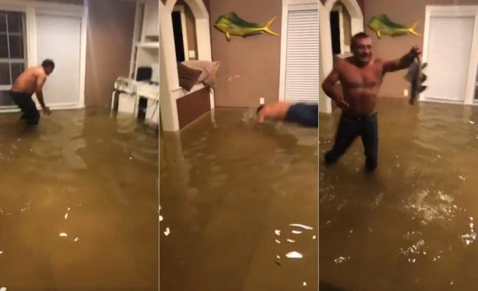Man goes fishing in flooded house after Hurricane Harvey""