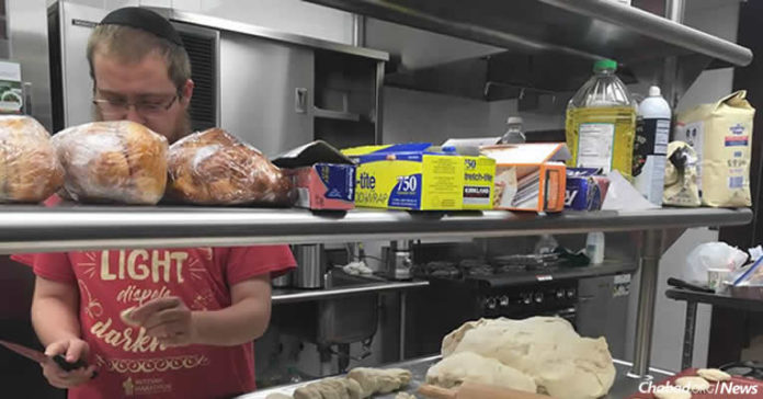 A volunteer at Aishel House at theTexas Medical Center in Houston, prepares kosher food for flood victims. With stores that carry kosher food items flooded, ...