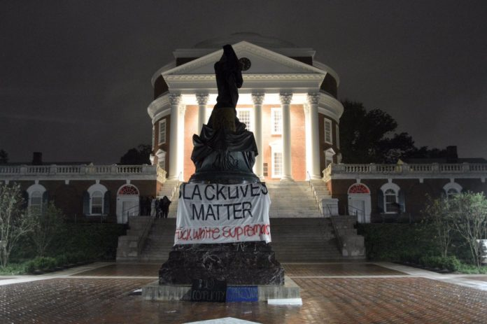 Black Lives Matter Protesters Cover Thomas Jefferson Statue In Charlottesville
