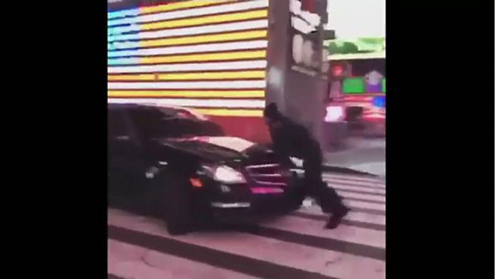 Auto seen on video clipping NYPD officer in Times Square