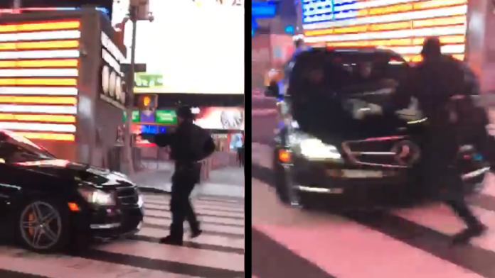 Suspects arrested after vehicle hits Times Square officer on video