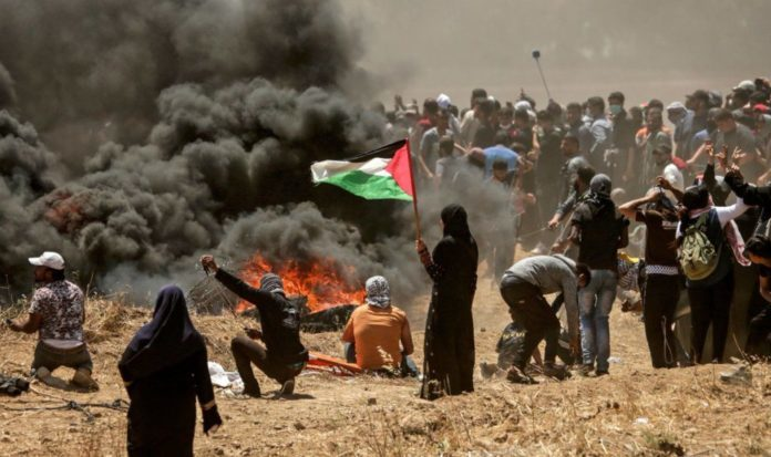 Palestinians and Israeli troops clash in West Bank on Nakba day